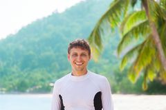 Man smile tropical island beach wear sport clothes Stock Images