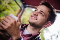 Man Smile Using Smart Phone Call, Communication On Line Social Message Near Window Royalty Free Stock Photo