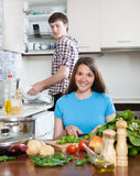Man and smile woman cooking Stock Photography
