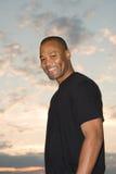 man smiles as daylight arrives royalty free stock photos