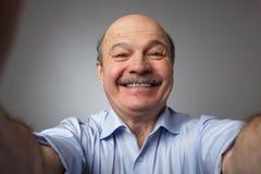 Man smiles on photo camera Stock Image