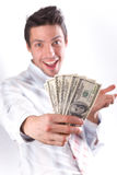 Man smiles and stretches money. Man in a white shirt and a red tie on a white background. The businessman smiles and stretches money. Dollars are developed by a Royalty Free Stock Photos