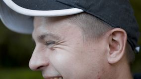Man smiles at the summer day outdoors.  stock footage