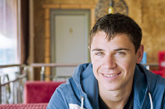 Man smiling. Young smiling man sitting in a cafe Stock Photography