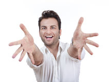 Man smiling, arms outstretched Stock Photo