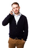 Man smiling as he chats on his mobile phone Stock Photos