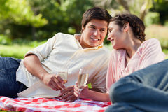 Man smiling as he looks at his friend during a picnic Stock Image