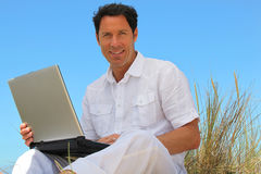 Man smiling on the beach Royalty Free Stock Images