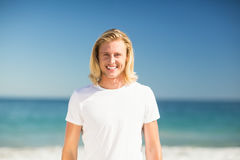 Man smiling on beach Stock Photo
