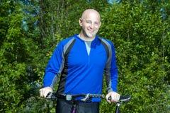 Man Smiling by Bicycle - horizontal Royalty Free Stock Image
