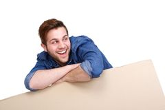 Man smiling with blank cardboard sign Royalty Free Stock Photo