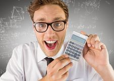 Man smiling with calculator against white math doodles and grey background Royalty Free Stock Image