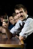 Man smiling for the camera at bar Royalty Free Stock Photos