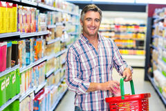 Man smiling at the camera while buying food Stock Photos