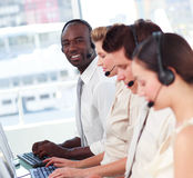 Man smiling at camera in a call centre stock images