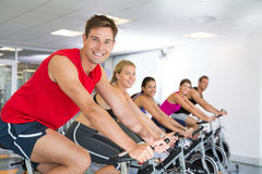 Man smiling at camera during spin class Royalty Free Stock Image