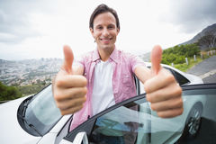 Man smiling at camera with thumbs up Royalty Free Stock Photography