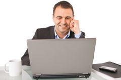 Man smiling chat laptop Stock Images