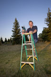 Man Smiling With Drill And Ladder Royalty Free Stock Photo