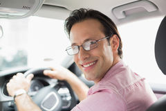 Man smiling while driving Royalty Free Stock Image