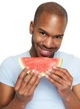 Man smiling and eating delicious watermelon Royalty Free Stock Photos