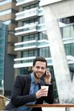 Man smiling and enjoying coffee Royalty Free Stock Images