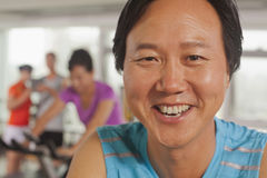 Man smiling and exercising on the exercise bike Stock Photography