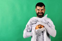 Man with smiling face expression on green background copy space. Man with smiling face expression on green background, copy space. Guy with beard holds smiling stock photos