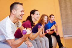 Man smiling in fitness class. With dumbbells in a health club Stock Photos