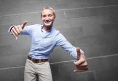 Man smiling and gesturing with hands Royalty Free Stock Images