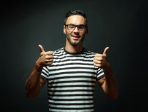 Man smiling and giving you two thumbs up Stock Photography