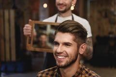 Man smiling in hair salon royalty free stock image
