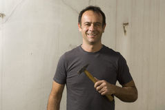 Man Smiling With Hammer - horizontal Royalty Free Stock Photo