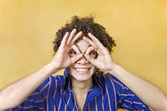 Man smiling with hand over eyes royalty free stock images