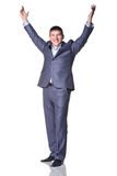 Man smiling with hands up Stock Photo