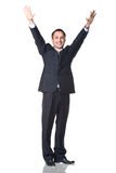 Man smiling with hands up Stock Image