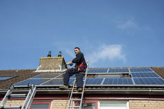 Man smiling and happy with solar panels Royalty Free Stock Image