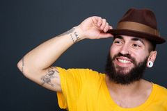 Man smiling with hat on gray background Royalty Free Stock Images