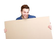 Man smiling and holding blank sign Royalty Free Stock Photography