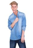 Man smiling and holding blue shirt Stock Photography