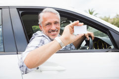 Man smiling and holding card Stock Photo