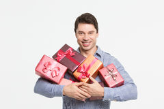 Man smiling and holding gifts on the hands Royalty Free Stock Photos