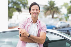 Man smiling and holding key Stock Photo