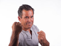 Man smiling infighting position Royalty Free Stock Photography