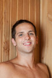 Man smiling inside the sauna Royalty Free Stock Photo