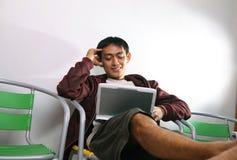 Man smiling on laptop. At home Royalty Free Stock Photos