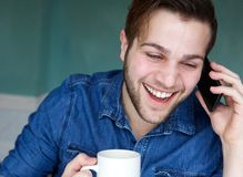 Man smiling with mobile phone Royalty Free Stock Images