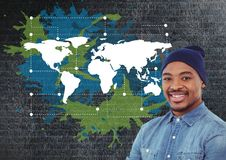 Man smiling net to Colorful Map with paint splatters on wall background Royalty Free Stock Images