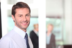 Man smiling in the office. Man smiling in an office environmant Royalty Free Stock Image