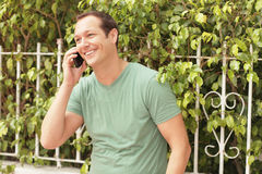 Man smiling on the phone Stock Image